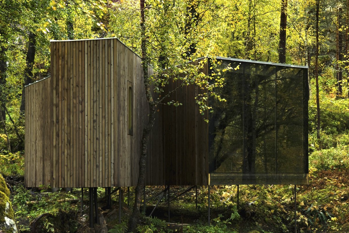 the-juvet-hotel-is-made-up-of-nine-wood-paneled-pods-scattered-throughout-the-woods-ownerknut-slinning-tells-business-insider-two-guests-can-stay-in-each-pod